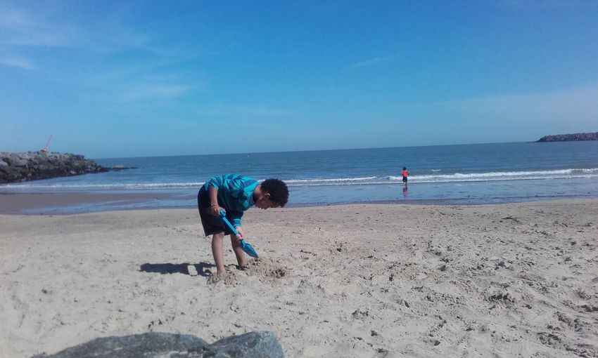 Boys Playing On Shore At Beach
