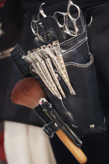 Close-up of tools in pouch