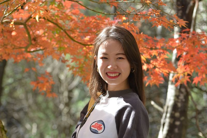 EyeEm Selects Smiling One Person Portrait Autumn Real People Women Leaf Standing Headshot Casual Clothing Outdoors Lifestyles Nature Plant Leisure Activity Happiness Tree