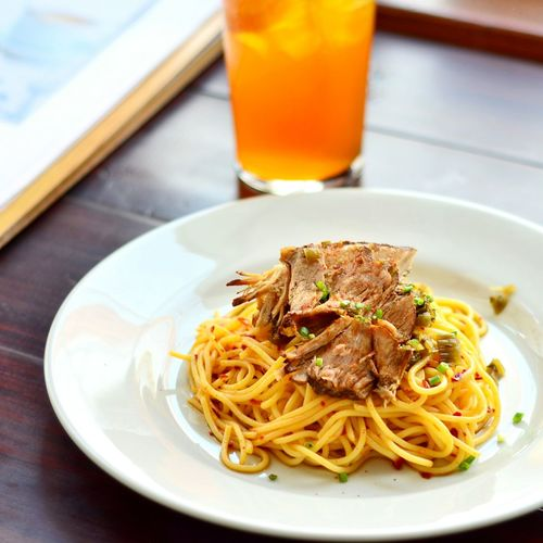 Close-up of noodles and drink on table