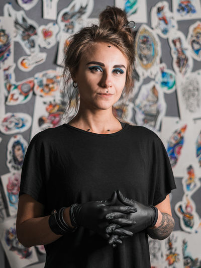 Piercing master, portrait One Person Indoors  Looking At Camera Portrait Young Adult Creativity Waist Up Standing Front View Real People Graffiti Art And Craft Wall - Building Feature Casual Clothing Lifestyles Young Women Leisure Activity Focus On Foreground Hairstyle
