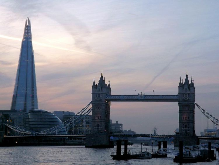 The Shard, City Hall, Tower Bridge and the River Thames in one capture Architecture Clouds And Sky View No People Connection Capital Cities  Travel Outdoors Capital City Famous Place Travel Destinations Sky International Landmark Structure Bridge - Man Made Structure Cloud - Sky Tall - High Shard London Bridge Skyscraper