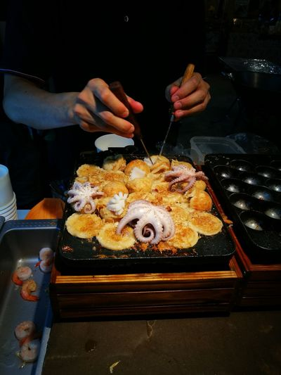 Takoyaki Adults Only Human Hand Food Human Body Part People Adult One Person One Man Only Indoors  Only Men Men Close-up Ready-to-eat Freshness Day