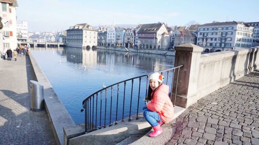 Railing City Outdoors Full Length One Woman Only Built Structure Only Women Women Building Exterior Happy People Happy Smiling Zürich Lake Lake View City Life Cityscape One Person Bridge - Man Made Structure Architecture People Water Day Building Terrace Miles Away