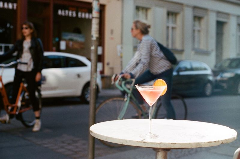 Martini cocktail on table at street