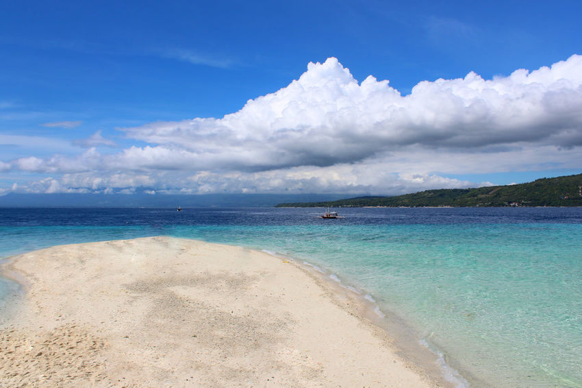 Beach Sea Sand Blue Cloud - Sky Water Sunny Island Sun Vacations Tropical Climate Sky Landscape Summer Travel Destinations Horizon Over Water Tourism Nature Travel
