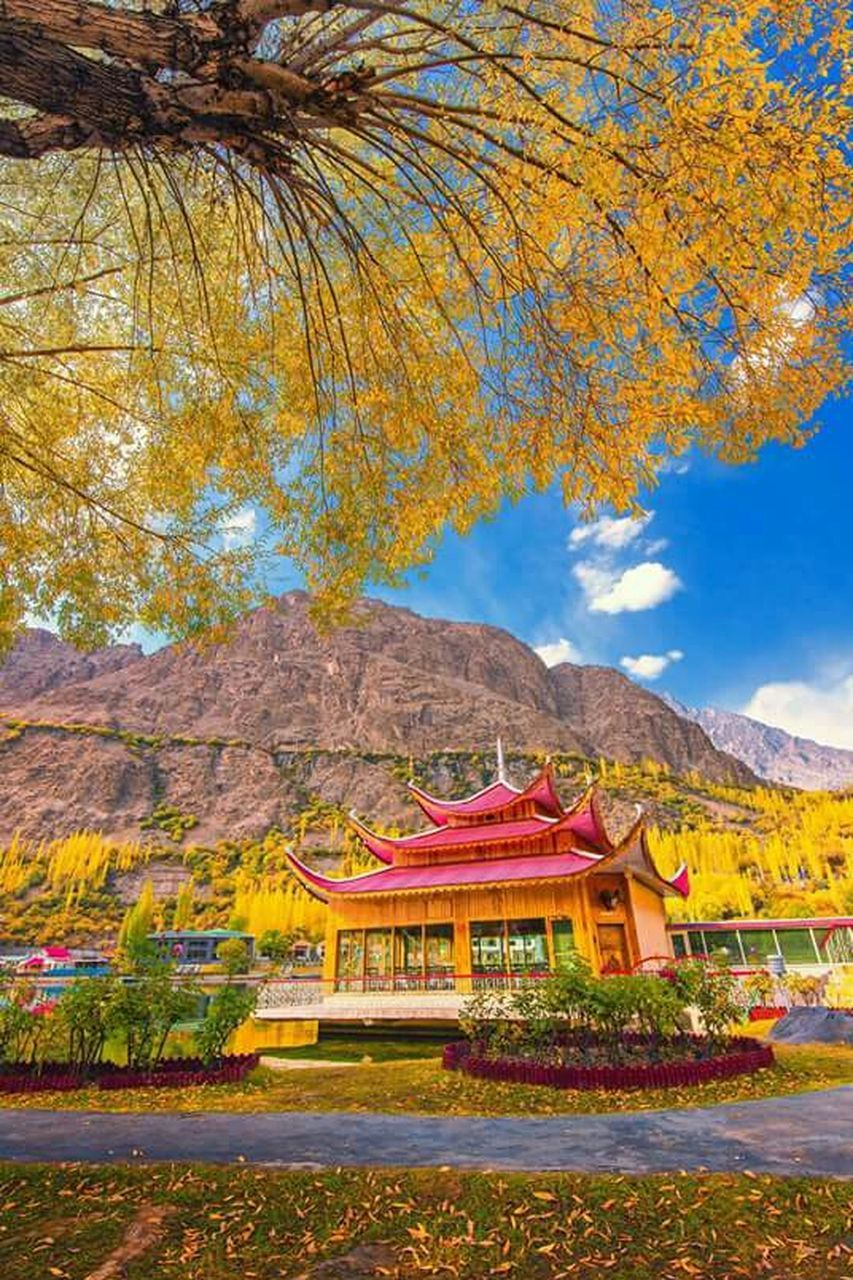 mountain, tree, travel destinations, red, mountain range, history, no people, day, architecture, outdoors, multi colored, autumn, scenics, building exterior, sky, nature