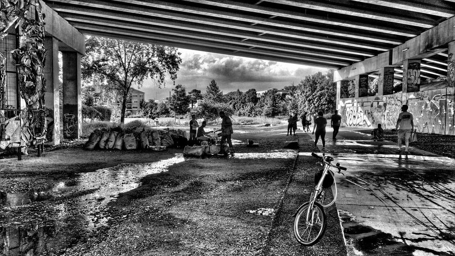Blackandwhite Notes From The Underground Urban Landscape Bicycle Streetphotography Concert as the rainstorm clears and the walkers, skaters, and bikers resume, the musicians play on...