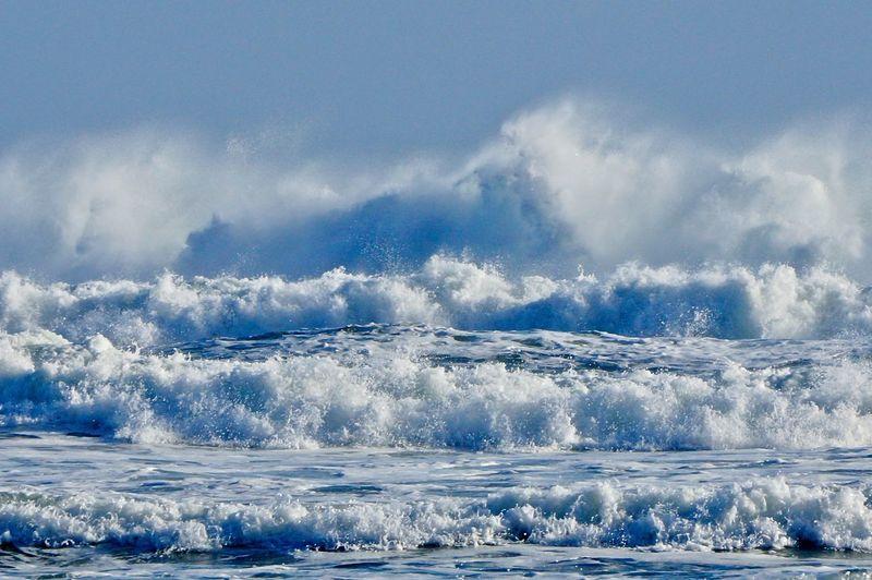 Scenic view of ocean waves against sky
