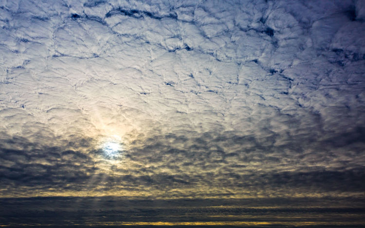 Sunrise behind cloud cover Sky Cloud - Sky No People Nature Beauty In Nature Scenics - Nature Tranquility Tranquil Scene Outdoors Pattern Backgrounds Day Textured  Sunlight Full Frame Cloud Cover Sunrise Sun