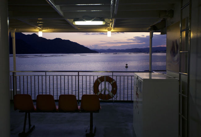 Architecture Beauty In Nature Chair Day Film Industry Home Showcase Interior Horizon Over Water Illuminated Indoors  Luxury Mountain Nature No People Scenics Sea Seat Sky Sunset Table Water Window