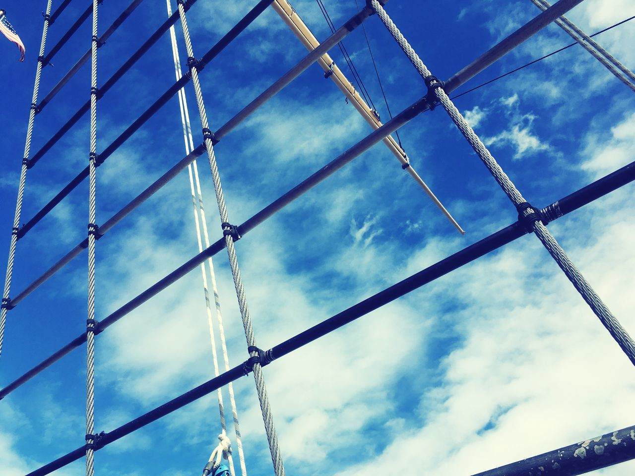 low angle view, sky, cloud - sky, metal, no people, day, backgrounds, full frame, outdoors, pattern, blue, close-up, nature