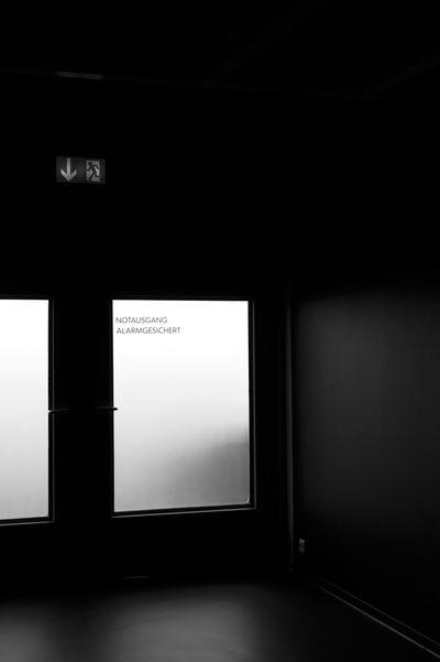 Notausgang alarmgesichert Dark Doors Architecture Blackandwhite Communication Day Emergency Exit Gloomy Indoors  Into The Light Monochrome No People Text Thriller Windows