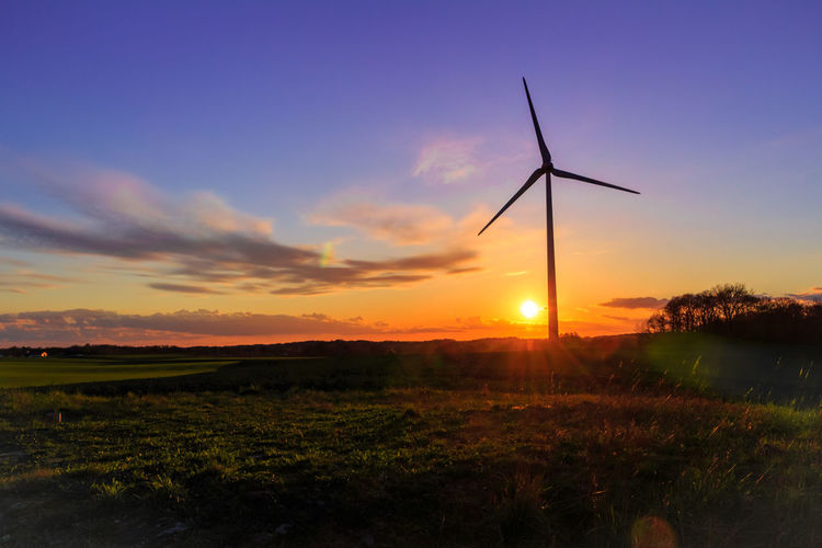 Sunset Alternative Energy Beauty In Nature Environmental Conservation Field Grass Idyllic Landscape Nature Non-urban Scene Orange Color Outdoors Renewable Energy Rural Scene Scenics Sky Sun Sunbeam Sunlight Sunset Traditional Windmill Tranquil Scene Tranquility Wind Power Wind Turbine Windmill