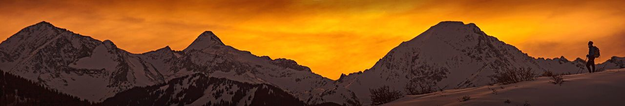 sunset, dramatic sky, rock - object, nature, outdoors, silhouette, mountain, sky, beauty in nature, scenics, panoramic, cloud - sky, no people, snow, day, galaxy