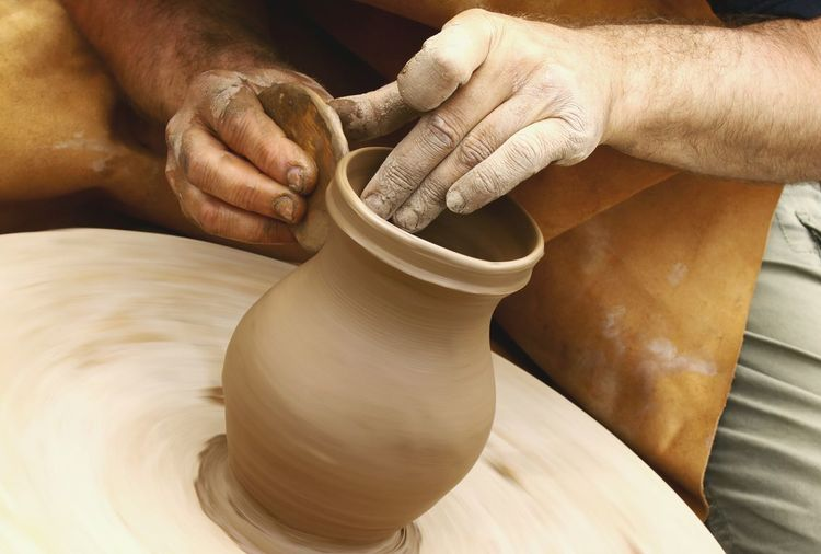MAN MAKING CLAY VASE