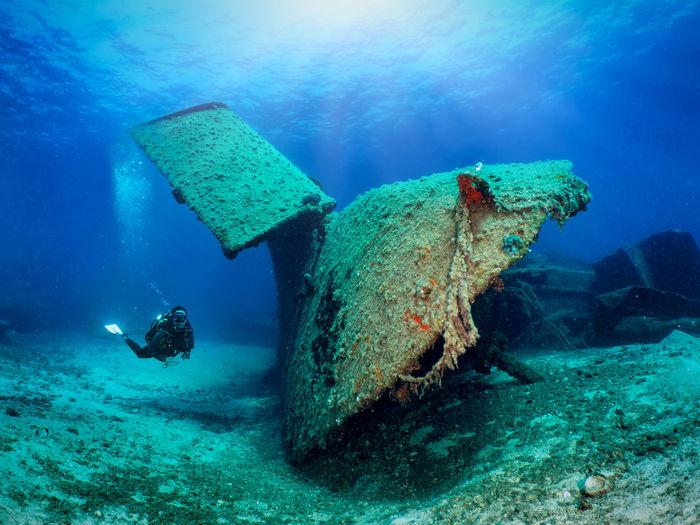 Full length of woman swimming underwater