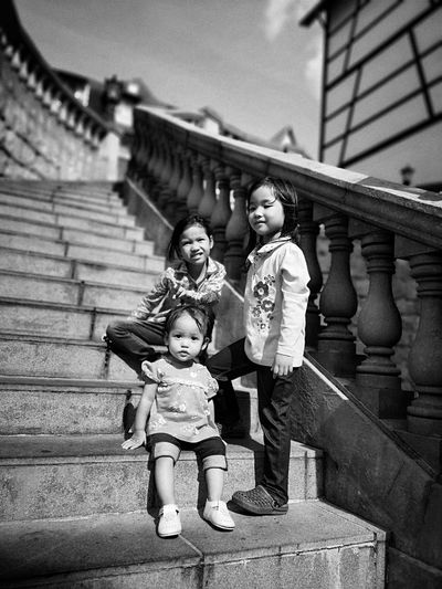 Siblings standing on steps