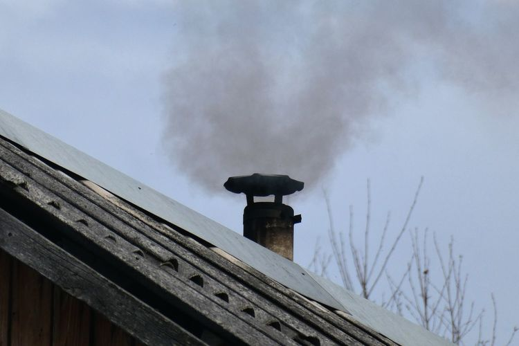 Sky Architecture Built Structure Cloud - Sky Wood - Material No People Day Nature Roof Building Exterior Low Angle View Outdoors Smoke - Physical Structure Chimney Cold Temperature Winter Building Smoke Stack Snow