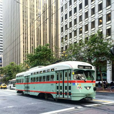 In 1989, San Francisco introduced a fleet of vintage trolleys to the run along downtown. These vintage gems add a lot of charm and color to the streets - to the delight of locals and tourists alike! High Rise Mobility In Mega Cities San Francisco, California Skyscrapers Teal Trolley Building Exterior No People Public Transportation Street Photography Transportation Vintage Cars