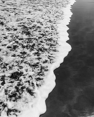 Rough Water Sea Beach Nature Day No People Beauty In Nature Land Motion High Angle View Tranquility Aquatic Sport Outdoors Sand Rock Waterfront Solid Textured  Abstract Blackandwhite