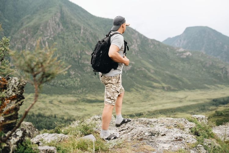Full length of man looking at mountains