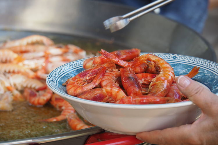 Food Stories Seafood Food Food And Drink Human Hand Freshness Day Shrimps Orange Pan Fry Frying Pan Frying Paella Oil Dish Bowl Mediterranean  Healthy Eating Fresh