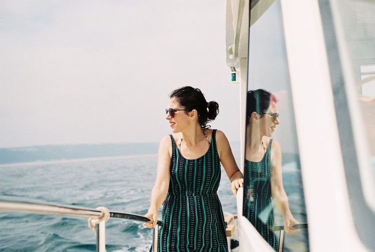 Smiling woman standing in boat