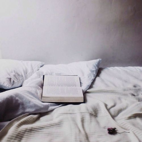 Open book on bed