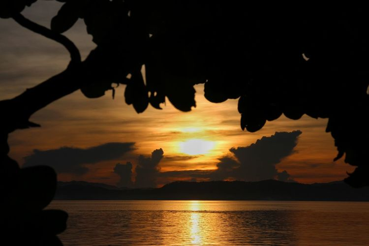 sunrise in San Antonio island, northern Samar Sunrise Silhouette Water Reflection Scenics Nature Sea Tranquility Cloud - Sky Beauty In Nature Tranquil Scene Sky Landscape No People Travel Destinations Vacations Outdoors Horizon Over Water Day Philippines Northern Samar