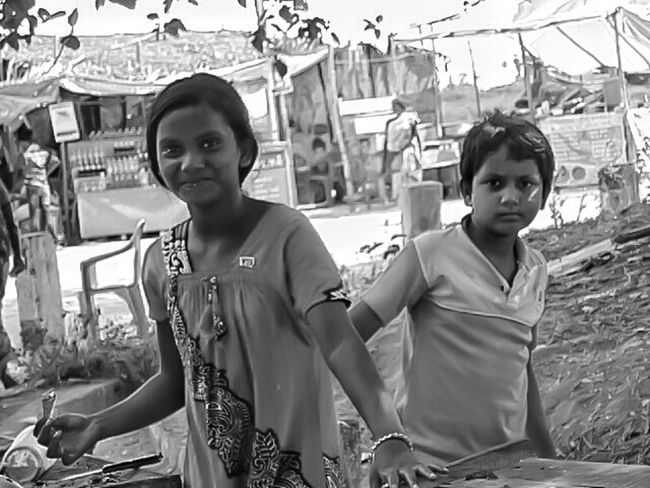 A trail on B&w; comments r welcomed i'll improve on it further!!!!! On Road Photography Looking At Things Simple Clothing Simple Moment My First Pic On EyeEm Taking Time To See The Little Things Photo Of The Day Close-up EyeEm Best Shots Street Photography Portrait Of Innocence At Road Unknown People Casual Look The Photojournalist – 2016 EyeEm Awards Casual Clothing The Street Photographer - 2016 EyeEm Awards The Portraitist - 2016 EyeEm Awards Shop Keeper Looking At Me Strange Brother & Sister Simple Smilee :) Looking At Camera Back And White Version Portrait In Black And White