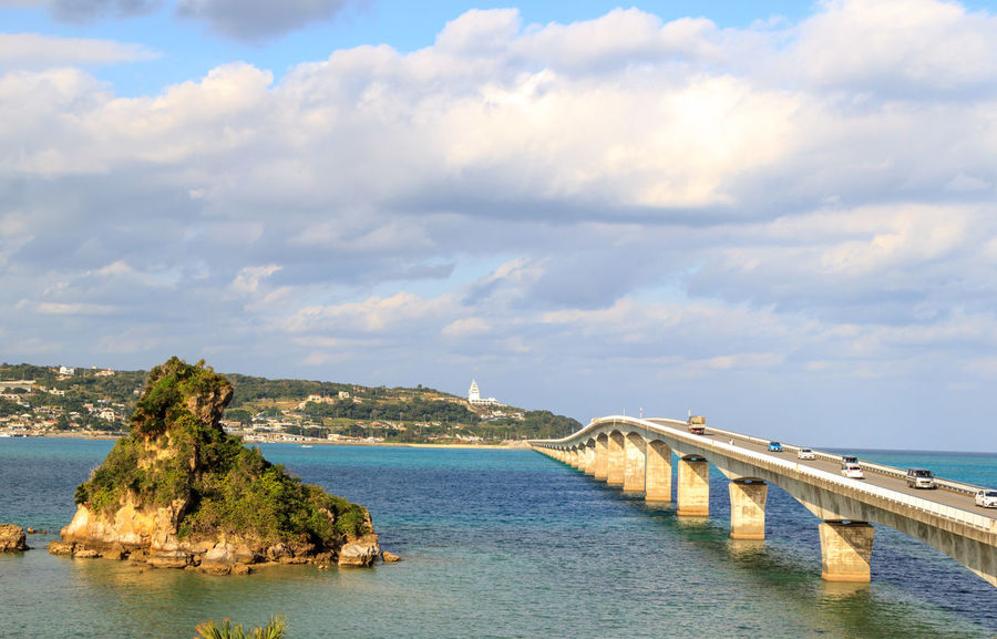 Long bridge connecting an isolated island Arch Bridge Architecture Beauty In Nature Bridge Bridge - Man Made Structure Built Structure Cloud - Sky Connection Day Idyllic Nature No People Outdoors Scenics - Nature Sea Sky Tranquil Scene Tranquility Transportation Water Waterfront