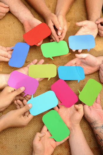 Hands holding blank speech bubbles Bubbles Community Hands Talking Pictures Teamwork Blank Communication Conversation Group Group Discussions Group Of Objects Group Of People Help Lots Speech Bubble Togetherness Voting