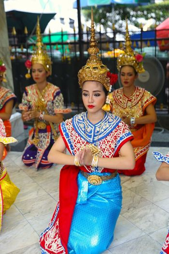 Traditional Thai Temple Dance Art Bangkok Thailand. Buddhist Temple Buddhist Temple In Thailand Casual Clothing Culture Cultures Fun Leisure Activity Lifestyles Multi Colored Portrait Sitting Street Streetphotography Tahiland Temple Dance Tradition Travel Travel Photography Traveling