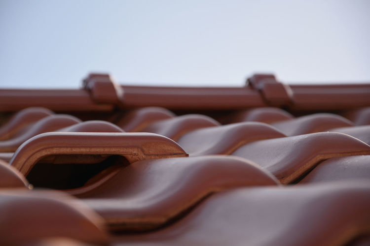 Ventilator on the roof In A Row Selective Focus No People Sky Indoors  Close-up Brown Copy Space Day Ceramic Tiles Clear Sky Large Group Of Objects Pattern Roof Tile Nature Architecture Roof