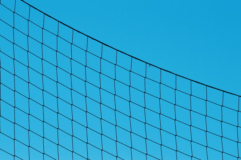 NAT Bakgrund Sky Sport Pattern Net Net Pattern Backgrounds Background Blue Still Life Outdoors StillLifePhotography Protection Street Photography Light Sunlight Shape Shapes Geometric Shape Clear Sky Blue Sky Architecture Parallel Square Shape Full Frame Abstract Backgrounds Repetition Textured  My Best Photo The Minimalist - 2019 EyeEm Awards
