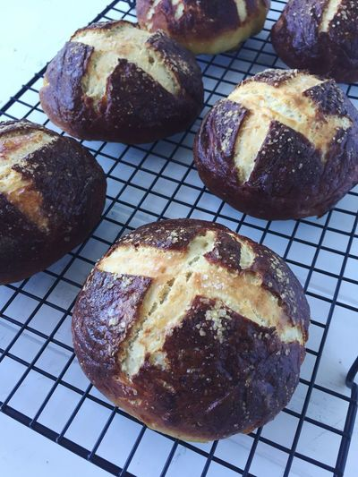 Food And Drink Food Bread Freshness Cooling Rack Baked Sweet Food No People Metal Grate Ready-to-eat Indulgence Cake Indoors  Temptation Close-up Dessert Bakery Day Loaf Of Bread Bread Roll Pretzelbuns pretzel hamburger buns
