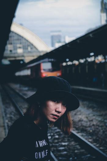 Portrait of woman standing on railroad station platform