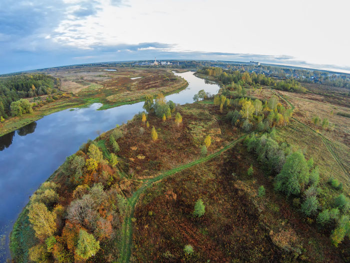 Aerial view of the river Mologa near the village. A Bird's Eye View Aerial View Beauty In Nature Beauty In Nature Day Drone  Landscape Nature No People Outdoors River Rural Scene Scenics Sky Top Perspective Tourism Tree Water Winding Road