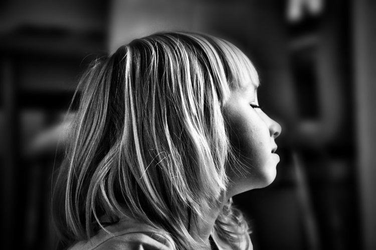 Side View Of Girl At Home