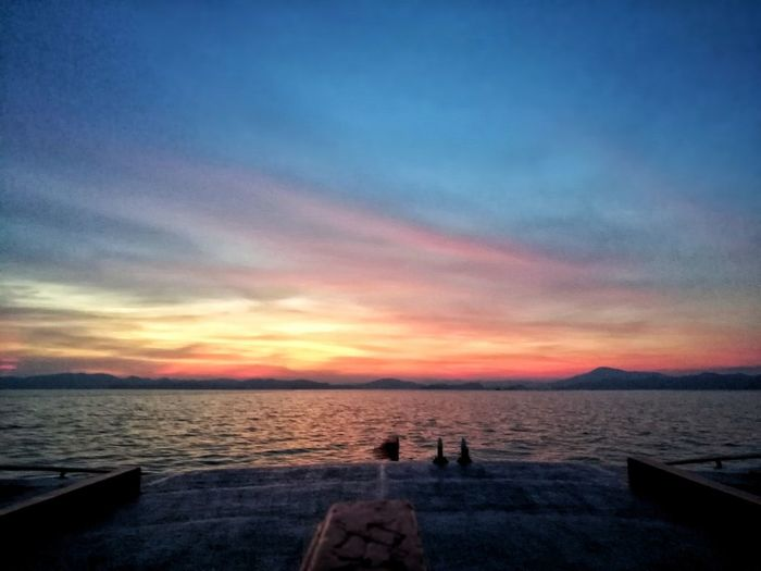 Beautiful sunset at the sea. Sunset Sea Sky Water Tranquility Scenics Beauty In Nature Nature Horizon Over Water Beach Cloud - Sky