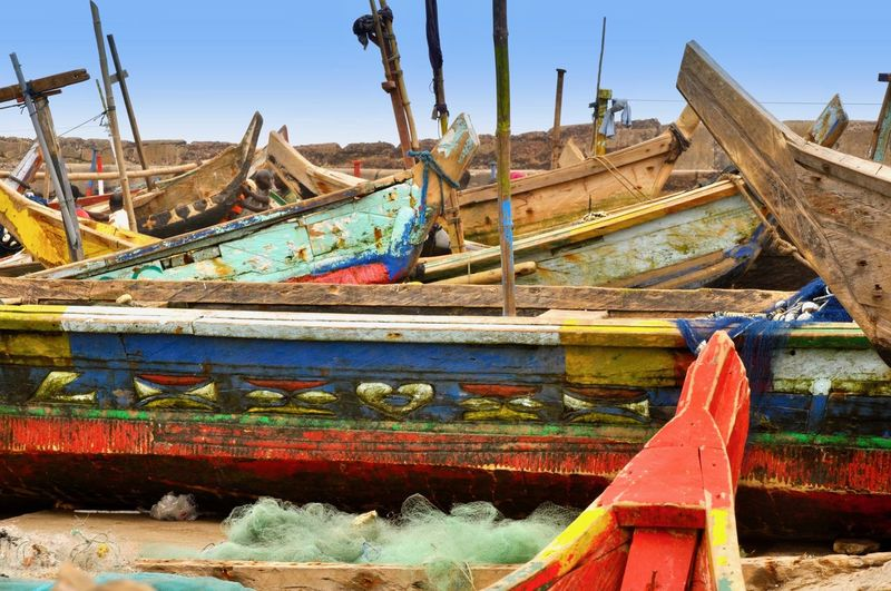 Fishing boats on sand at beach