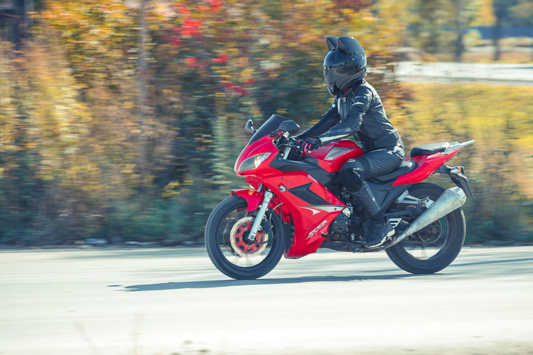 Autumn Biker Blurred Motion Change Crash Helmet Day Full Length Headwear Helmet Land Vehicle Leather Lifestyles Mode Of Transportation Motion Motorcycle Nature One Person Outdoors Red Ride Riding Road Sports Helmet Transportation Tree