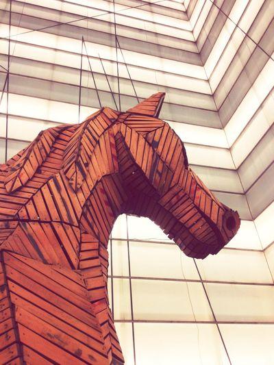 Cropped Image Of Trojan Horse Statue In Auditorium