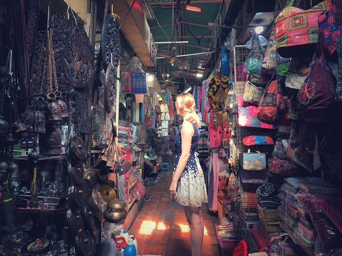 Side view of woman standing at market