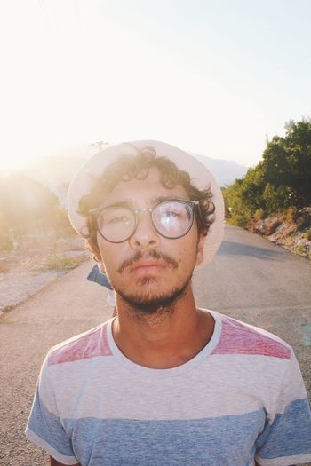 Me, as a stock photo One Person Portrait Front View Headshot Nature Day Sky Lifestyles Sunlight Clear Sky Young Adult Looking At Camera Glasses Tree