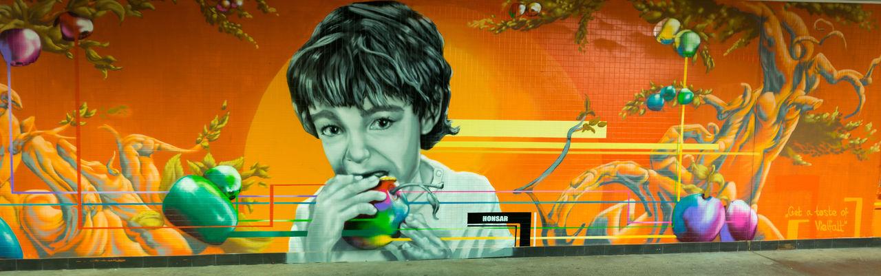 Portrait of boy with graffiti on wall