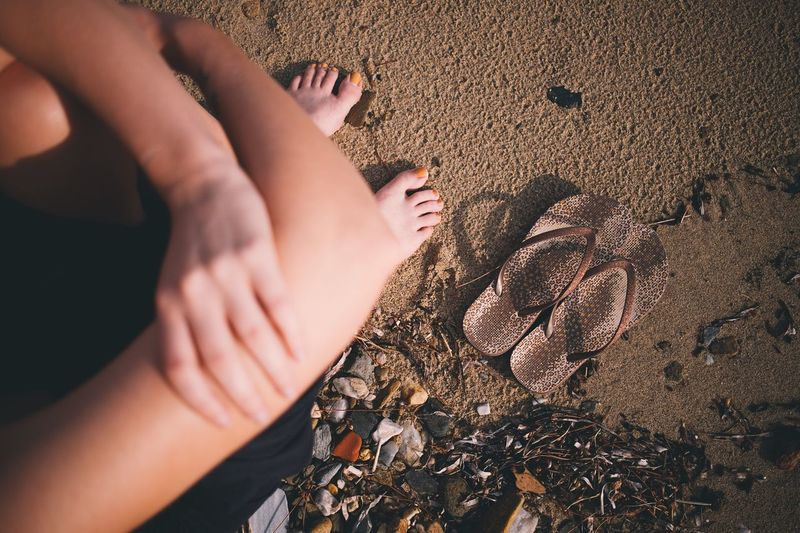 Human Body Part Body Part Human Leg Real People Sand Lifestyles Low Section Beach High Angle View Sunlight barefoot Land Leisure Activity People Nature Women Human Foot Adult Hand