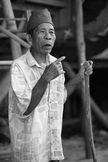 Uniqueness One Person Mature Adult Assistance Senior Adult One Senior Man Only Real People People Retirement Senior Men Nias Island INDONESIA Fine Art Oldness Wrinkled Skin Wrinkles Wrinkled Face Wrinkle Of Life Wrinkles Of A Long Life Lived Traditional Clothing B/W Portrait Authority Stick Of Greatness Wiseman Wisdom Miles Away