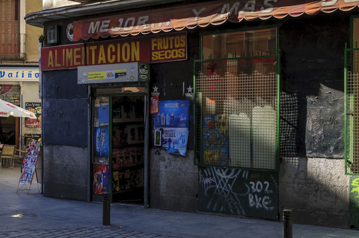 A view of a old style food shop in one of the side streets in the histroical centre of Madrid. Alimentacion Architecture Building Exterior Built Structure Business City Corner Shop Editorial  Grocery Shopping Historical No People Old Old Buildings Shop Store Street Shop Streetphotography Tourism Travel